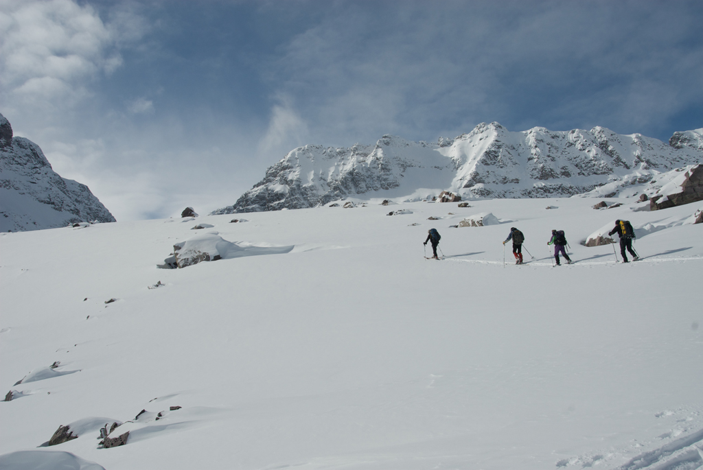 Vance, Ivan, Margo and Derry enjoy the sunny weather and explore the valley above Fryatt Hut.